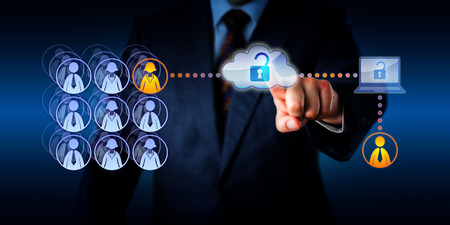 Photo pour Hand of a manager unlocking cloud network access to connect with a male zero-hours contractor. This remote freelance worker is aiding a female permanent employee with a task via a secure connection. - image libre de droit