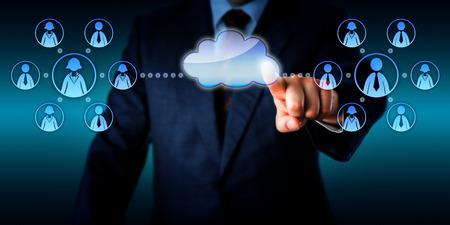 Photo pour Torso of an IT consultant is connecting two work teams in the cloud via touch.   - image libre de droit