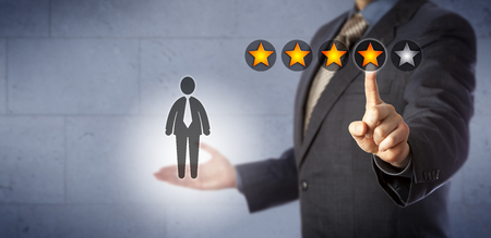 Foto de Blue chip human resources manager is giving a male employee a four star rating out of five. Business concept for performance review and monitoring, talent management, career development discussion. - Imagen libre de derechos