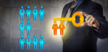Photo pour Unrecognizable HR manager is unlocking the potential of a work team with a virtual key with workers for key bit. Concept for team building, talent management, success, solution and achievement. - image libre de droit