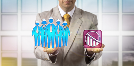 Photo for Unrecognizable HR manager is equating a team of five blue collar workers with a downward trend icon. HRM concept for demotion, team failure, moving down, wages, decrease in skilled manual labor. - Royalty Free Image