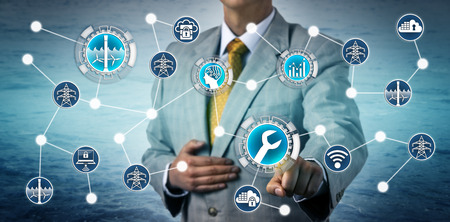 Foto de Corporate executive activating AI aided predictive maintenance on a tidal energy plant via the industrial internet of things. Industry and technology concept for energy management, power generation. - Imagen libre de derechos