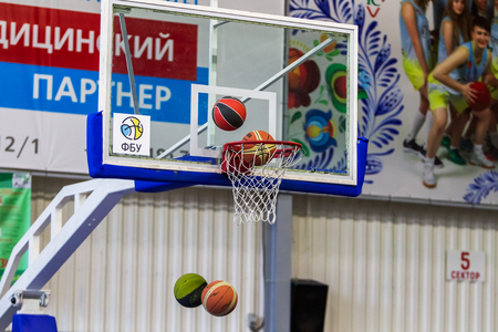 Photo pour Odessa, Ukraine - December 23, 2018: basketball balls fly into the basketball basket during the celebration of the children's sports basketball club of the children's sports school - image libre de droit