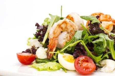 Photo pour salad greens and shrimp on a white background in the restaurant - image libre de droit