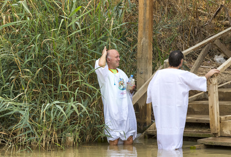 Photo for BETHABARA, ISRAEL- 25 NOVEMBER 2017: Pilgrims from different countries accept the rite of baptism in the Jordan River in Israel - Royalty Free Image