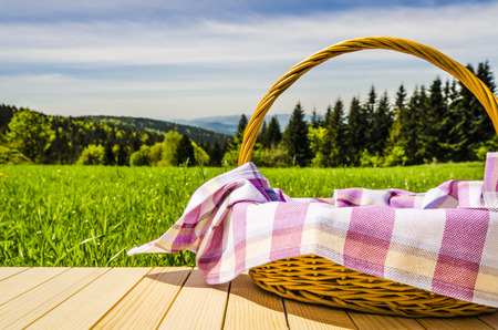 Photo for Picnic basket on wooden table - Royalty Free Image