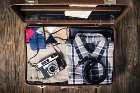 Foto de Vintage travel suitcase on wooden table - Imagen libre de derechos