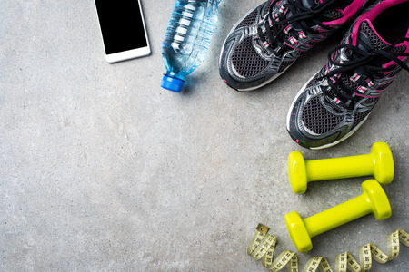 Sport accessories on gray stone background