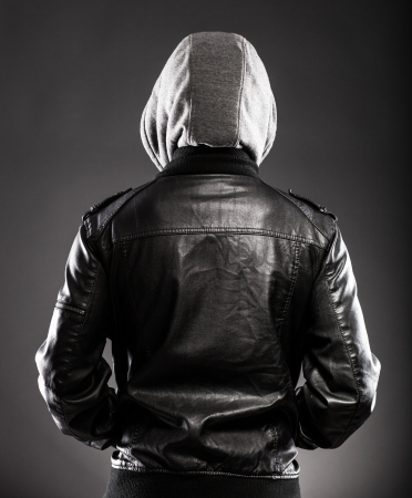 Photo for Young man in leather jacket and hood rear view on back - Royalty Free Image