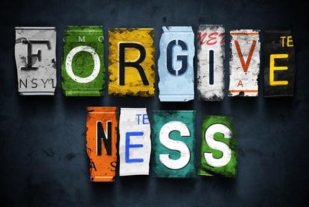 Photo pour Forgiveness word on vintage broken car license plates - image libre de droit