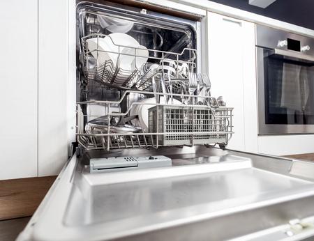 Foto de Clean dishes in dishwasher machine after washing cycle - Imagen libre de derechos