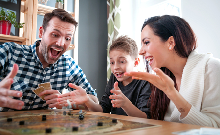 Photo for Happy family playing board game at home, happiness concept - Royalty Free Image