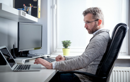Photo for Middle age man working in home office with computer laptop - Royalty Free Image