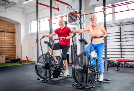 Photo for Senior couple biking at the gym - Royalty Free Image