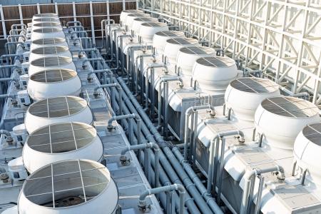 Photo pour Air conditioning systems on roof top - image libre de droit