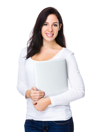 Brunette woman holding with laptop computer