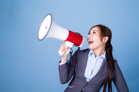 Photo for Businesswoman making announcement with megaphone - Royalty Free Image