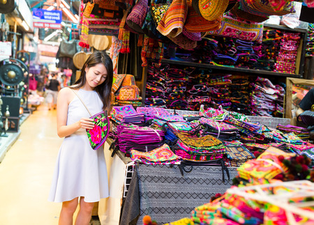 Photo for Young Woman shopping in weekend market - Royalty Free Image