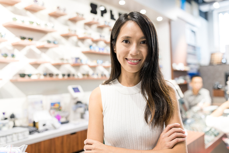 Foto de Young Woman holding small business in optical shop - Imagen libre de derechos