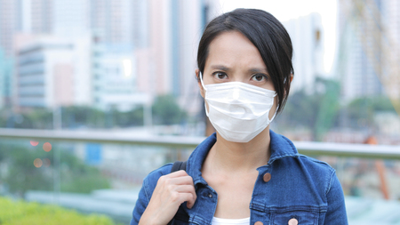 Photo for Woman wearing face mask in the city  - Royalty Free Image