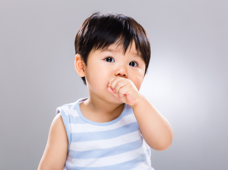 Photo for Asian baby son eating cookie - Royalty Free Image