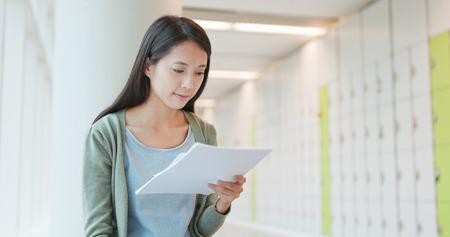 Foto de Woman reading on note at school - Imagen libre de derechos