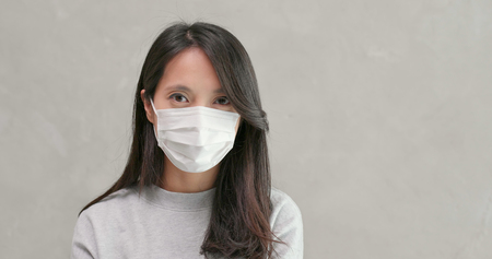 Photo pour Woman wearing face mask for protection - image libre de droit