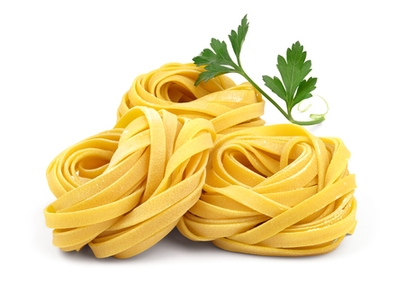 Foto de Italian rolled fresh fettuccine pasta with flour and parsley isolated on white background. - Imagen libre de derechos