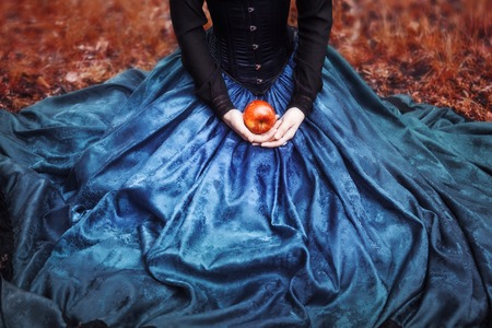 Photo for Snow White princess with the famous red apple. - Royalty Free Image