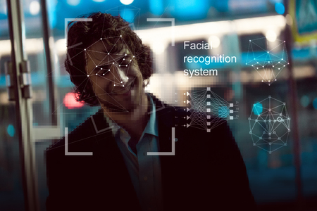Photo for Facial recognition system, concept. Young man on the street face recognition - Royalty Free Image