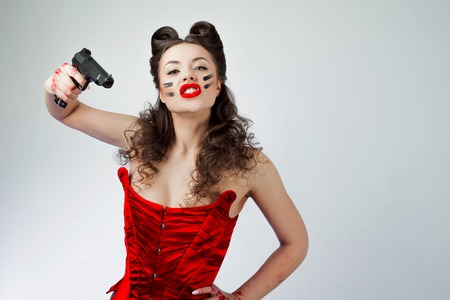 Photo for Charming lady in red corset. Sweetie Belle in war paint, girl power - Royalty Free Image
