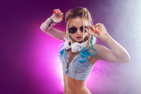 Photo for Young fashionable girl in disco style. Listening music and enjoying. Retro style - Royalty Free Image