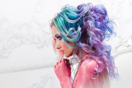 Photo pour Beautiful woman with bright hair. Bright hair color, hairstyle with the curls. - image libre de droit