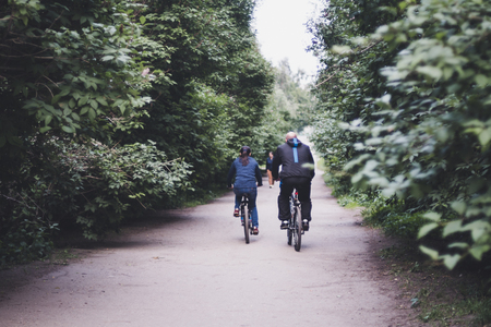 Two people on bicycles riding in park
