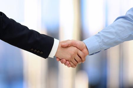 Foto de Close-up image of a firm handshake  between two colleagues in office. - Imagen libre de derechos