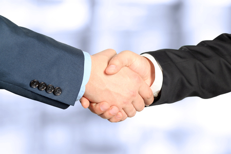 Foto de Close-up image of a firm handshake  between two colleagues - Imagen libre de derechos
