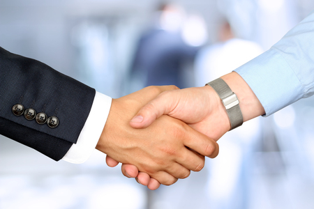 Photo for Close-up image of a firm handshake  between two colleagues - Royalty Free Image