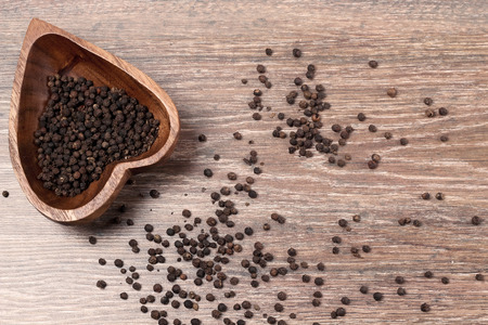 Photo for milled black pepper ,Black pepper corns on an old wooden background - Royalty Free Image