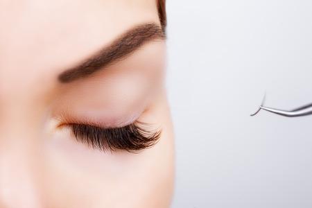 Photo for Woman Eye with Long Eyelashes. Eyelash Extension. Lashes. Close up, selected focus - Royalty Free Image