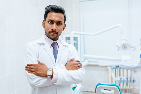 Photo for Portrait of a young confident asian male dentist in clinic. Dental clinic concept - Royalty Free Image
