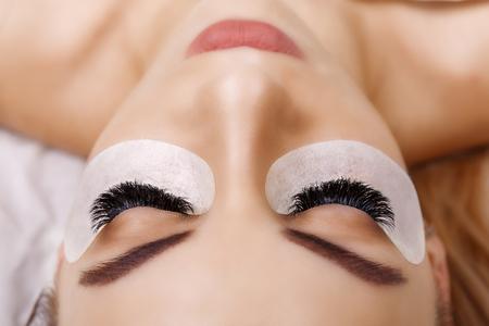 Foto de Eyelash Extension Procedure. Woman Eye with Long Eyelashes. Close up, selective focus. Hollywood, russian volume - Imagen libre de derechos