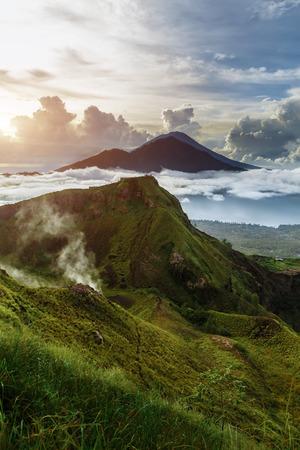 Foto de Active Indonesian volcano Batur in the tropical island Bali. Indonesia. Volcano sunrise serenity. Dawn sky at morning in mountain, travel concept - Imagen libre de derechos