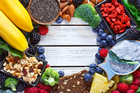 Photo pour Superfood. Frame of healthy vegan ingredients on white wooden board. Healthy food concept. - image libre de droit