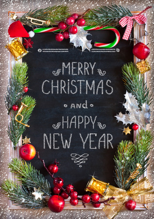 Foto de Chalk blackboard Christmas congratulation with Christmas decorations. Retro style. Christmas card. - Imagen libre de derechos