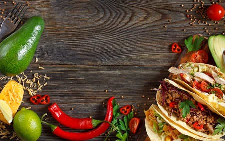Fresh delisious mexican tacos and food ingredients.