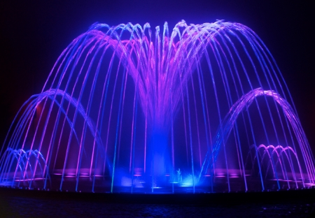 Photo for Colored water fountain at night - Royalty Free Image