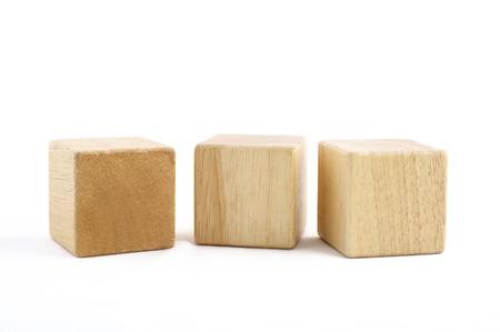 Photo pour Wooden toy blocks on white background - image libre de droit