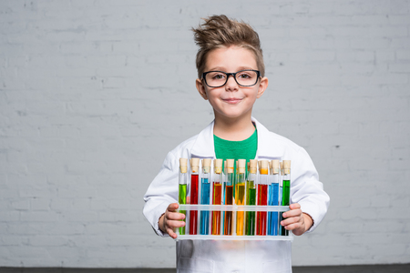 Photo for Little boy with test tubes - Royalty Free Image