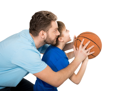 Foto de father with son playing basketball isolated on white - Imagen libre de derechos