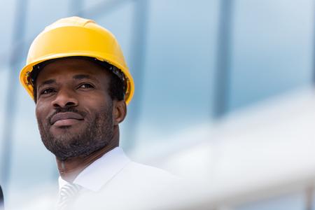 Photo pour professional architect in hard hat looking away - image libre de droit